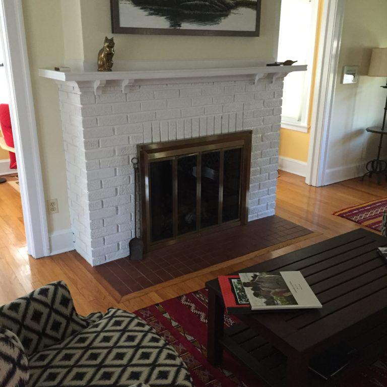 Ordinary White Brick Fireplace Prior to Makeover