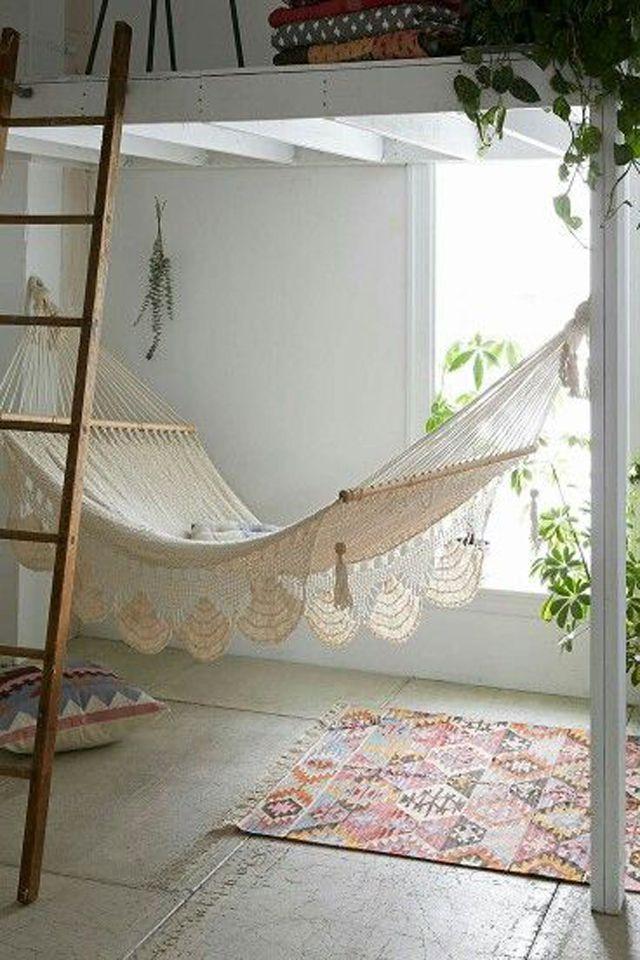 Boho macramé hammock suspended from loft bed