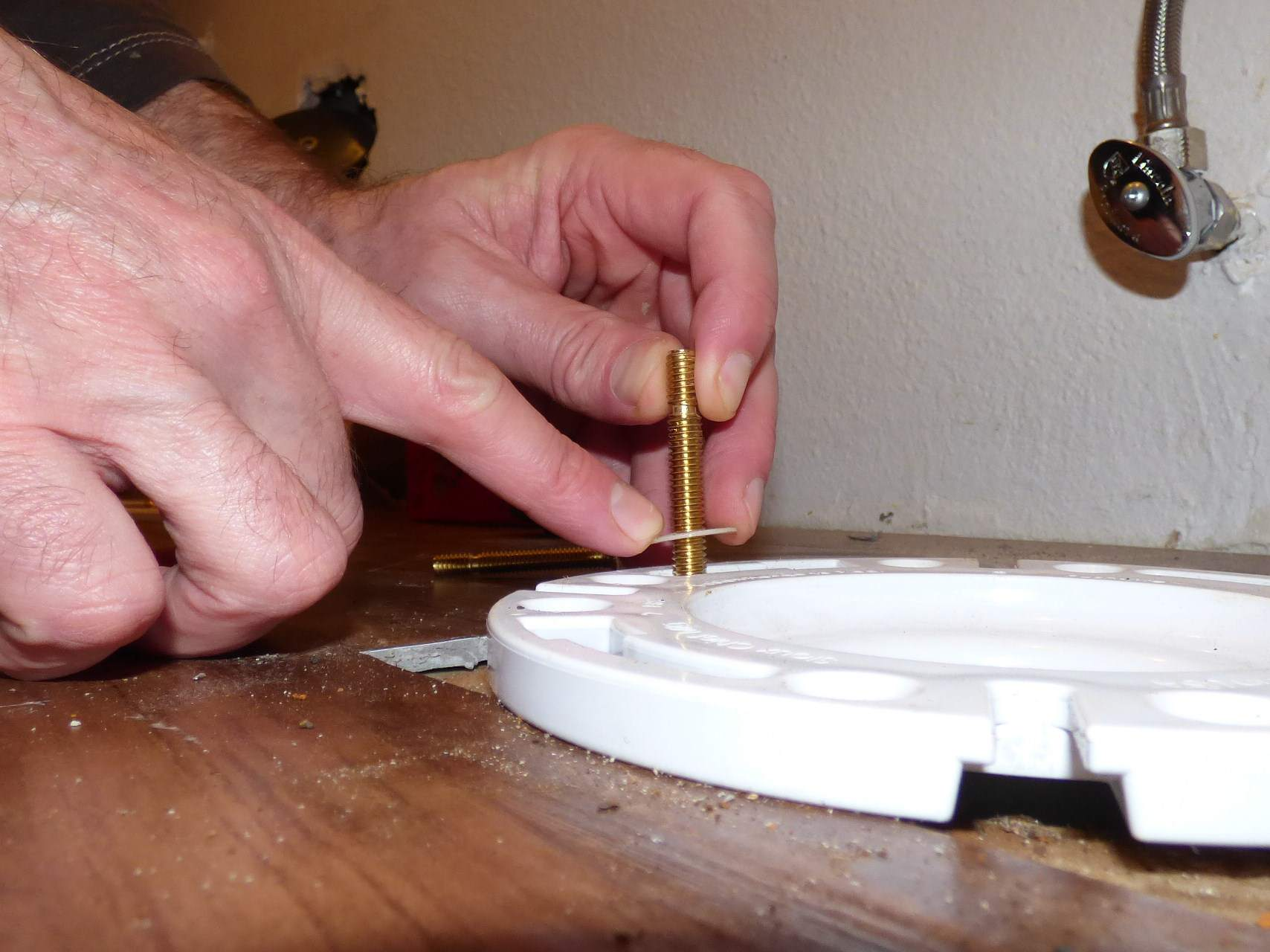 Person placing T-bolts on the flange.
