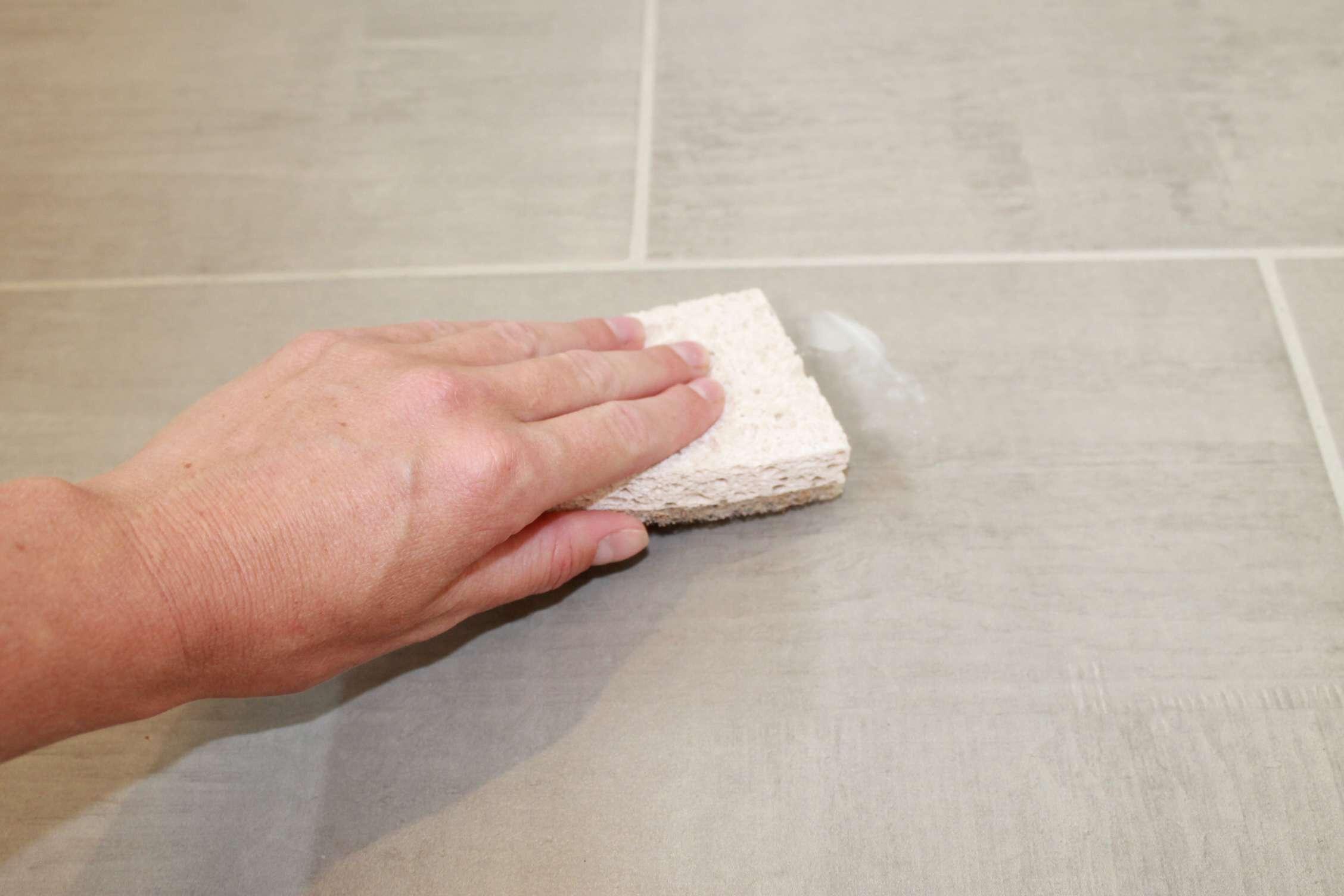 Scrub sticky areas with sponge