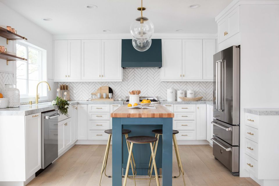 Coastal kitchen with herringbone backsplash