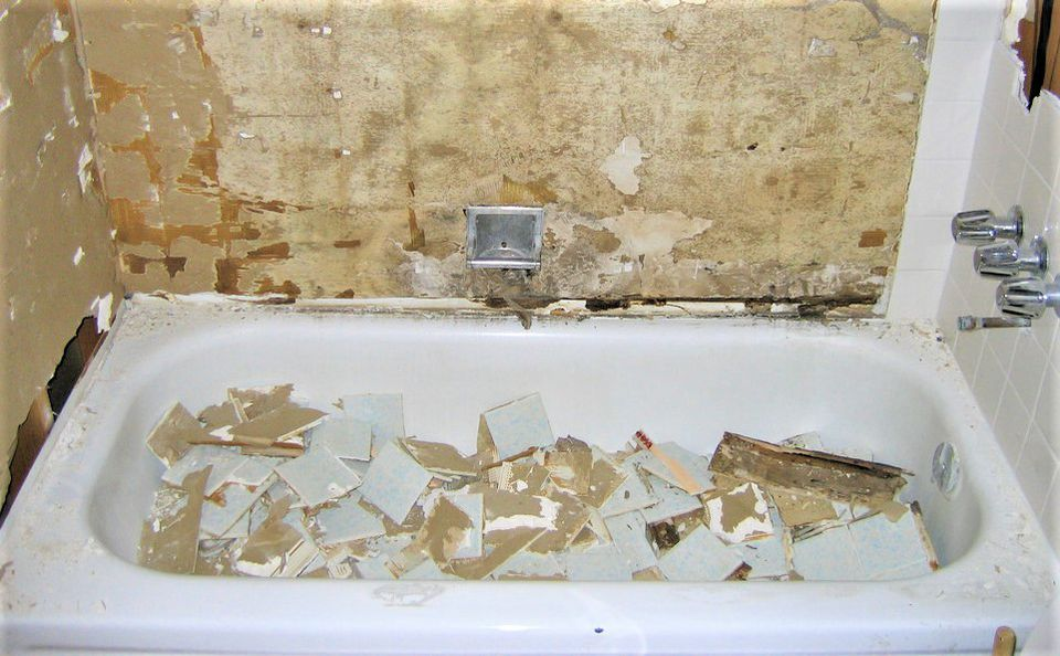 Construction debris in bathtub presents special difficulties when it comes time to clean the tub