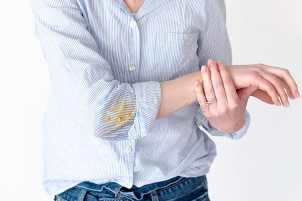 a mystery stain on a woman's blouse