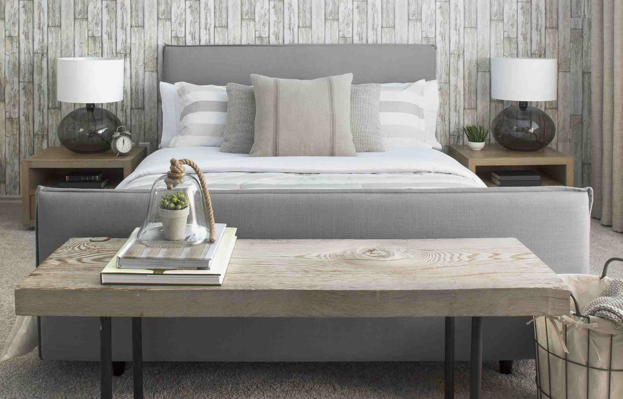A well appointed bedroom with wood paneling