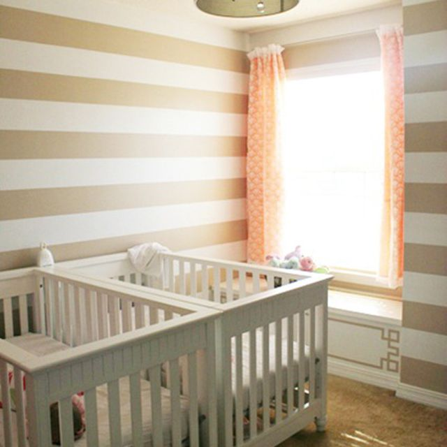 Space-saving twin nursery crib placement