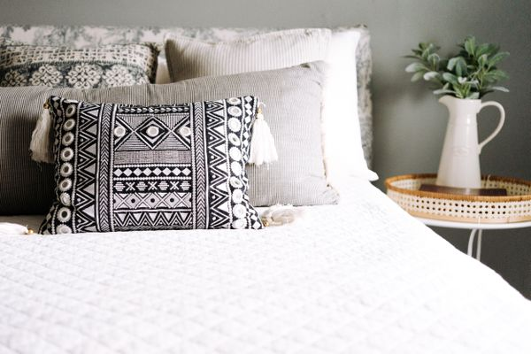 throw pillows on a bed