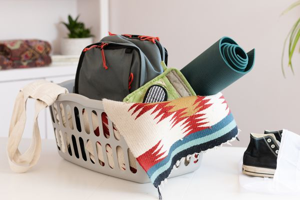 Laundry basket with household items