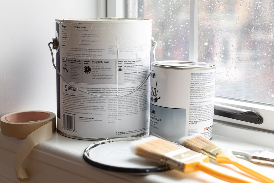 paint cans near a rainy window
