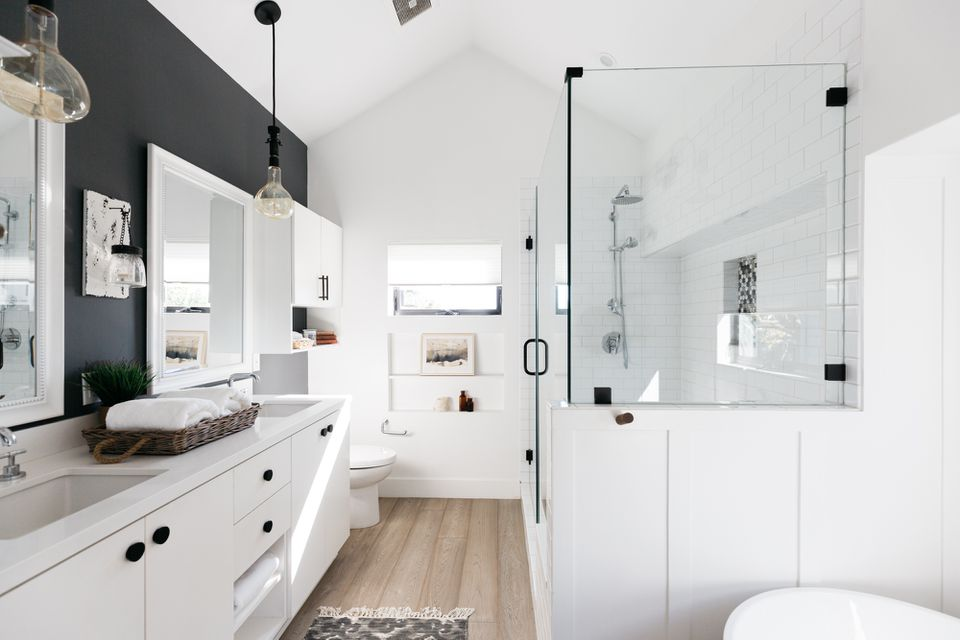 Beautiful bathroom with white cabinets and black wall accent