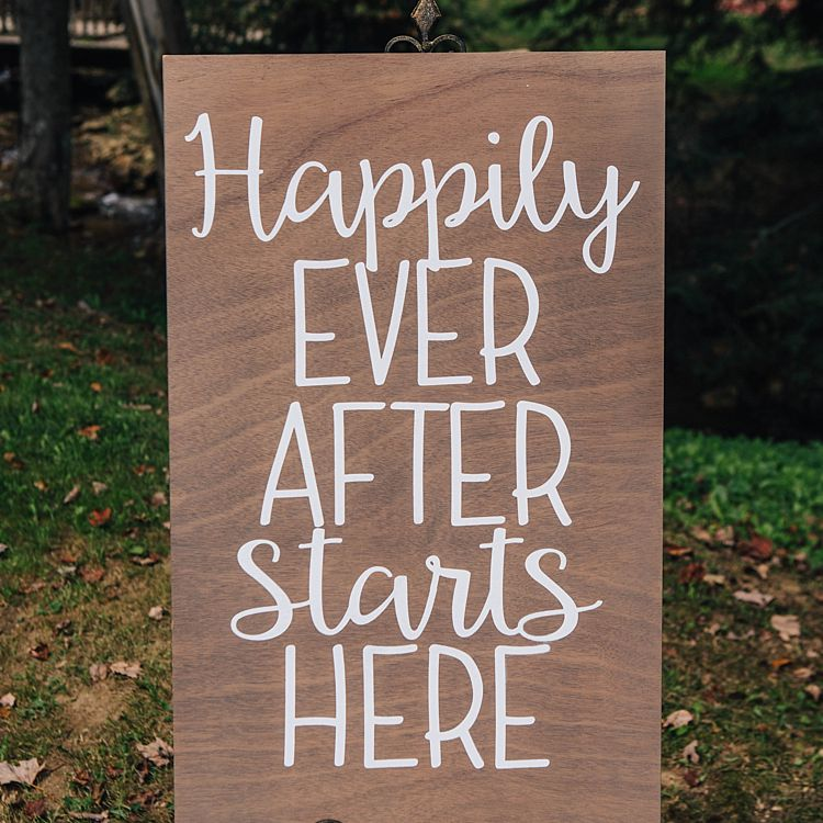 """sign that says """"happily ever after starts here"""""""