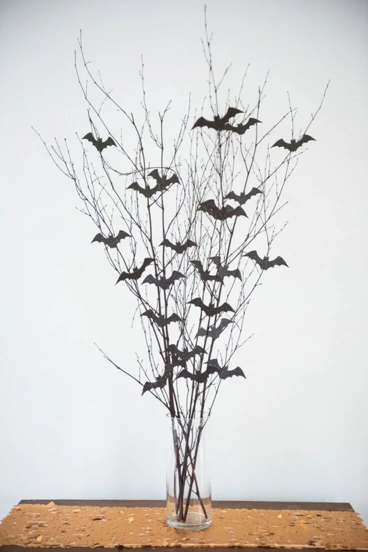 Branches with black bats