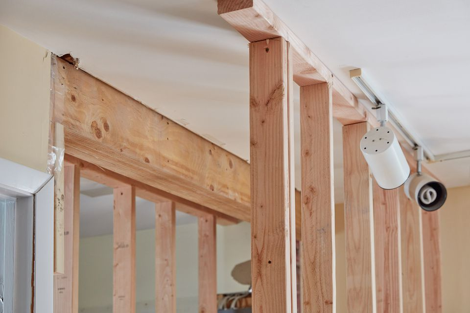 Load bearing wall with wood support beams
