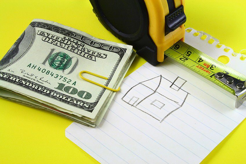 money, tape measure, drawing of a house