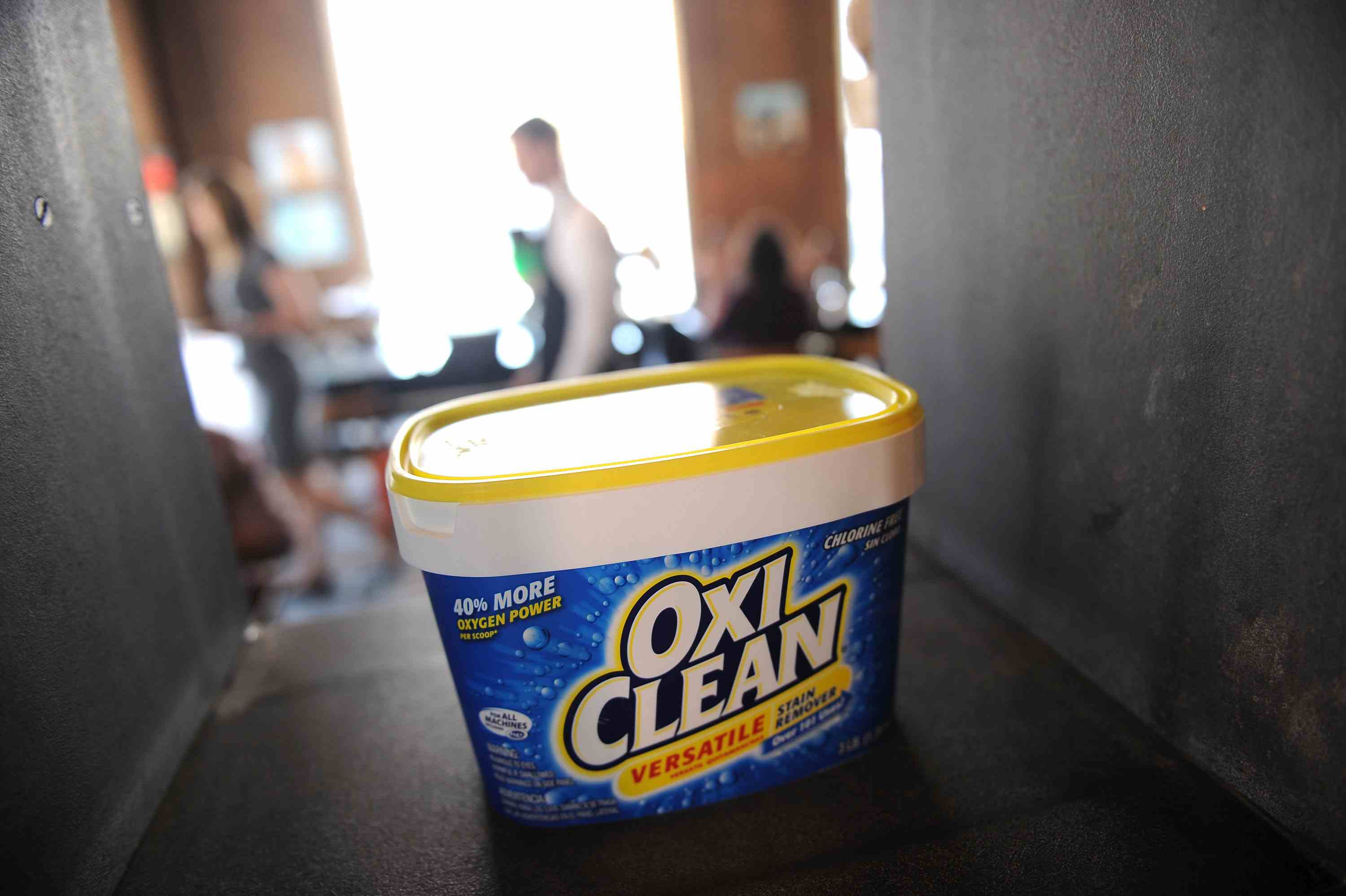 Container of OxiClean on a shelf.