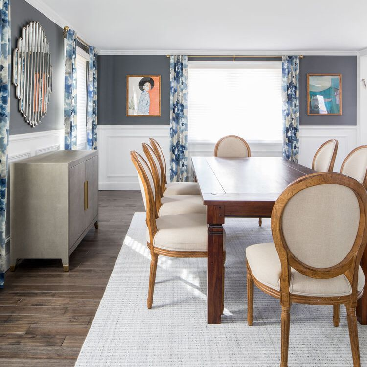 gray blue dining room with artwork