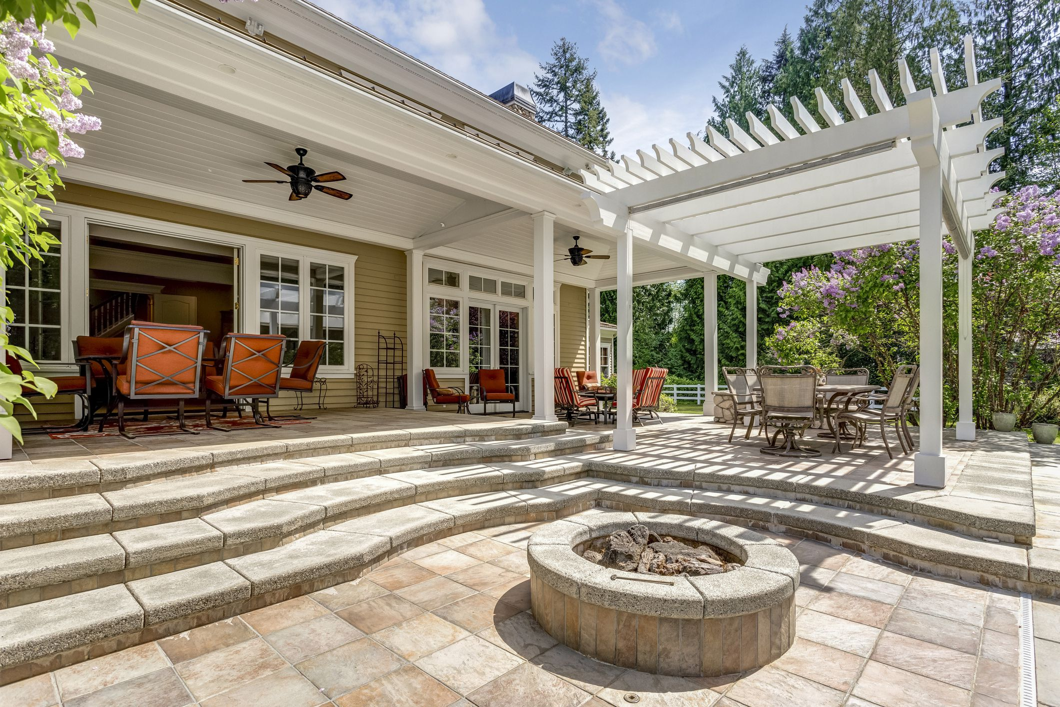 Lovely outdoor deck patio space with white dining pergola.