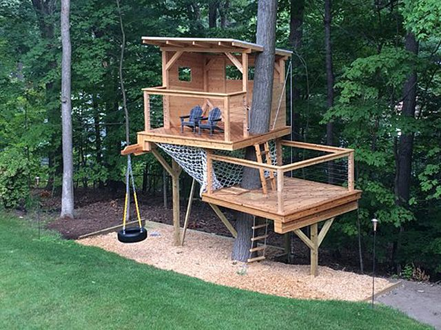 Two-story tree house with cargo net