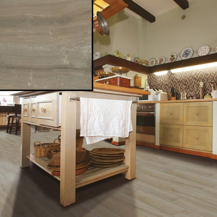 Ceramic tile that looks like oak wood flooring in a kitchen.