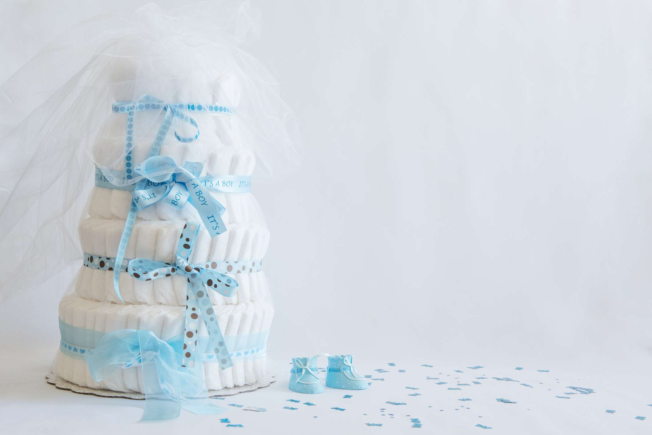 Diaper Cake and baby boy shoes for a baby shower