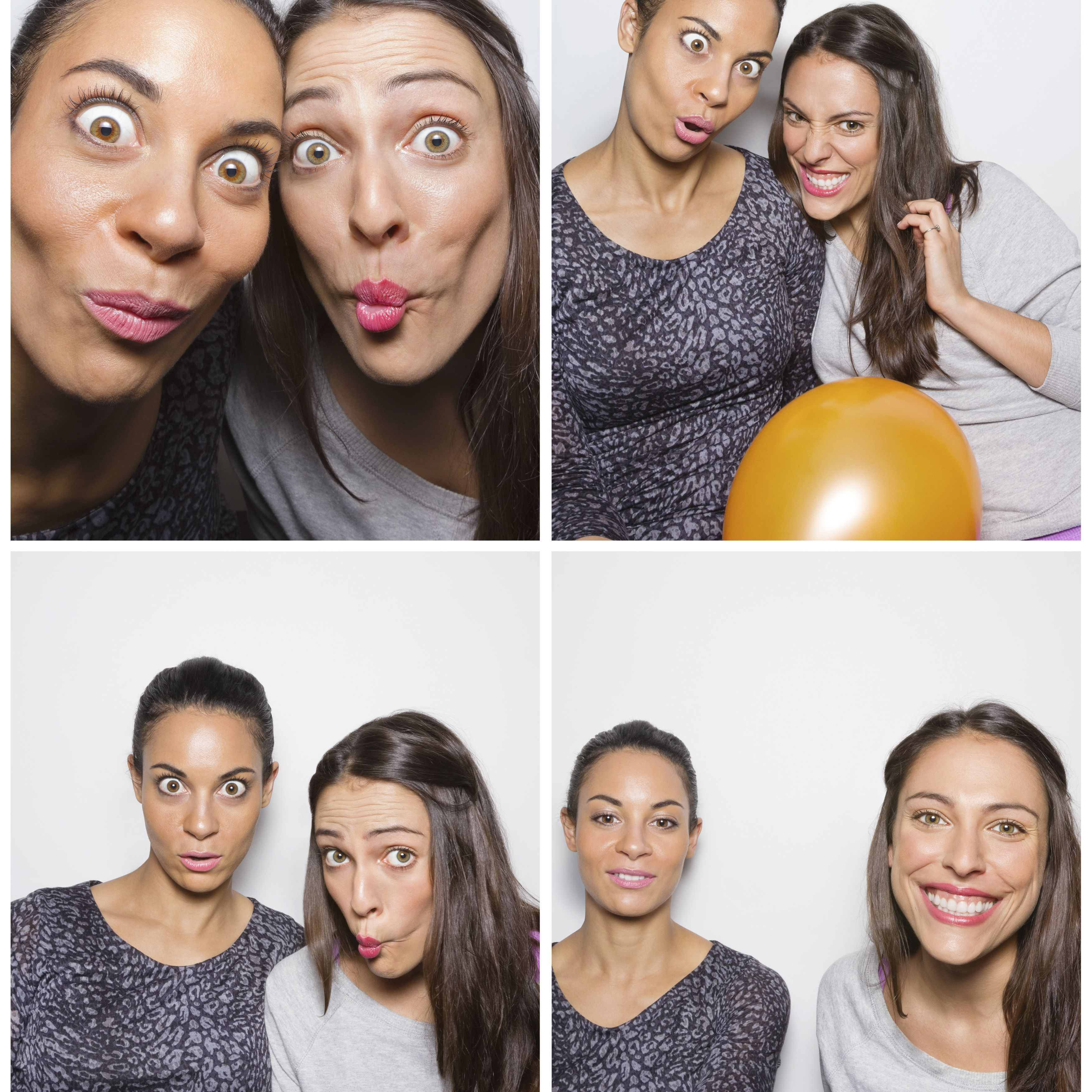 Young women pulling faces in photo booth
