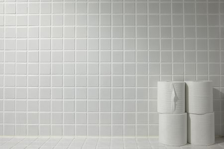 Toilet Paper Placed On A Tiled