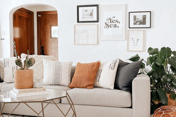 gallery wall above a sofa