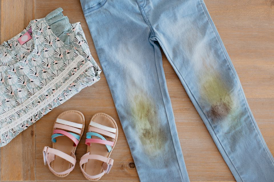 child's clothing with grass stains