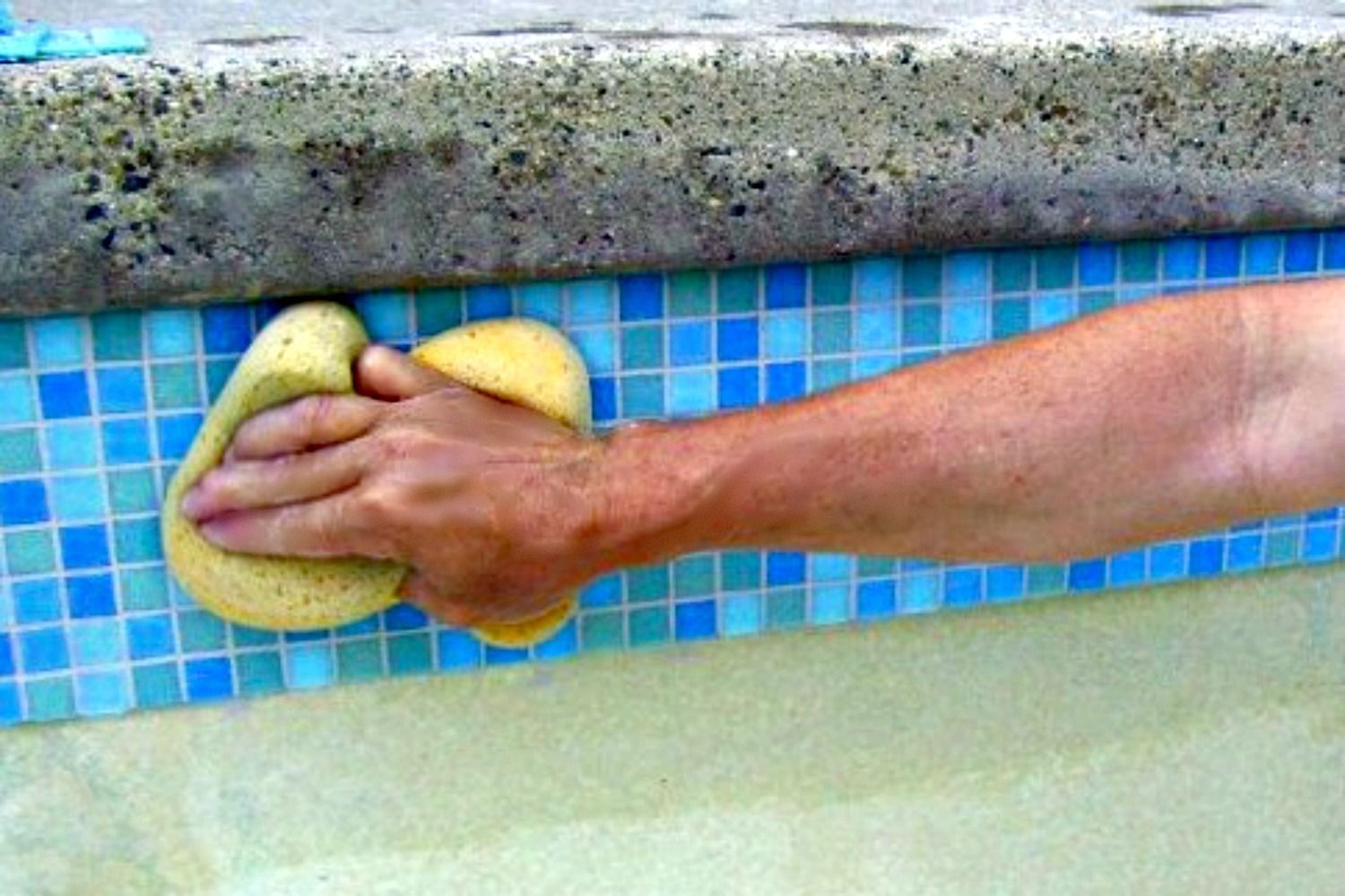 Cleaning Water Line Tile in Swimming Pool