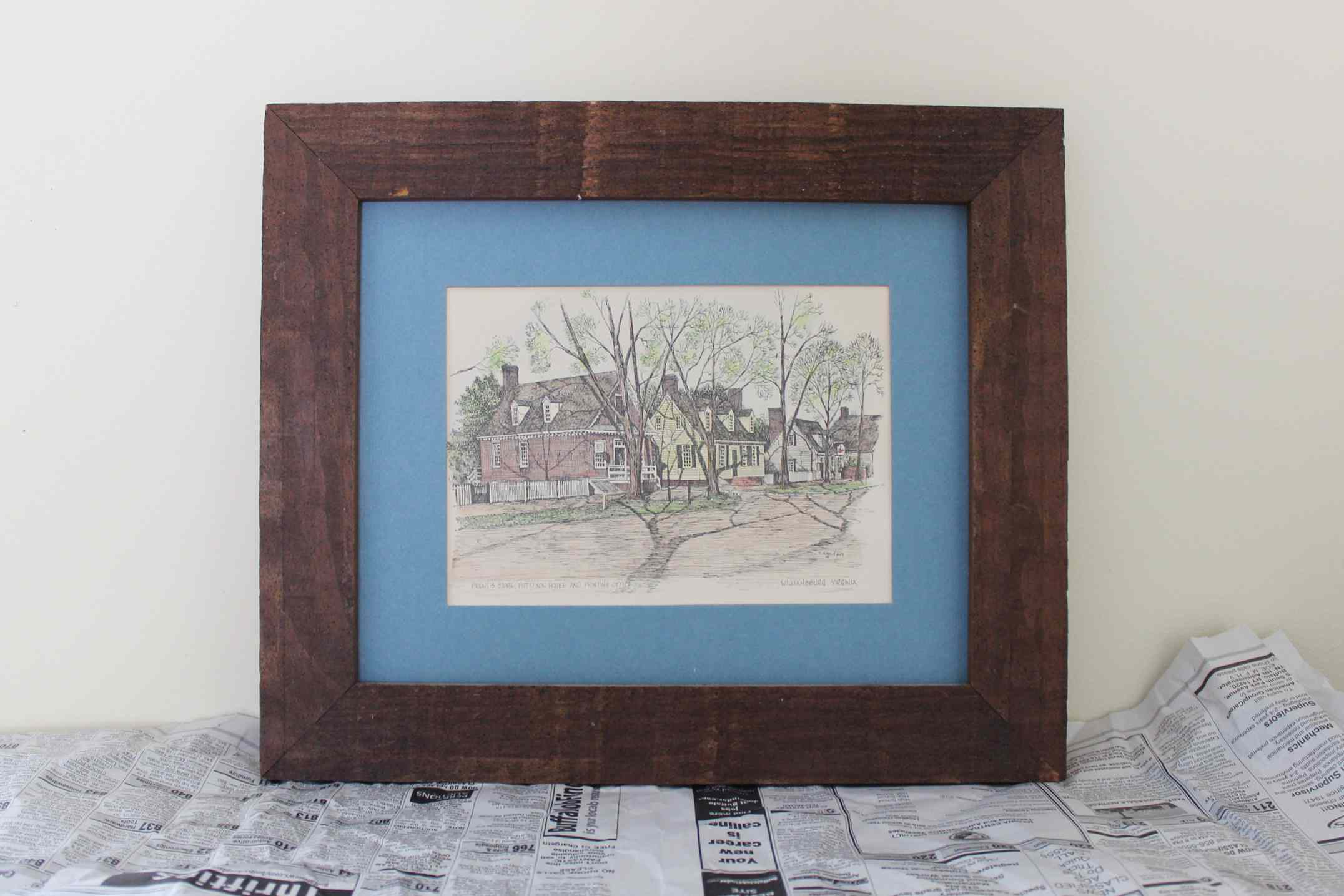 old picture frame on newspaper
