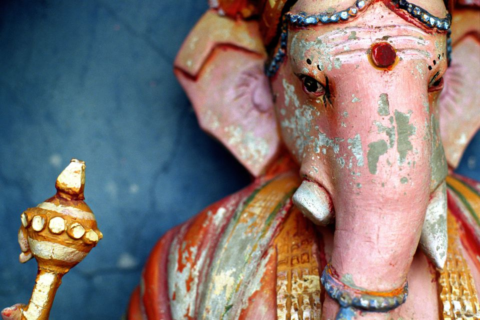 Ganesh statue in front of a blue wall