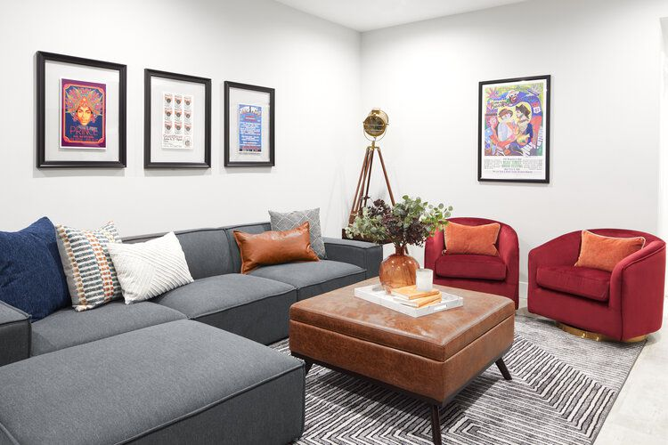 art above sofa in colorful basement