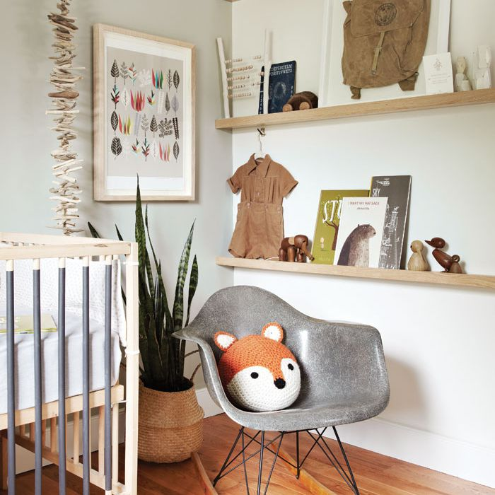 Simple nursery with neutral colors and an understated woodland theme
