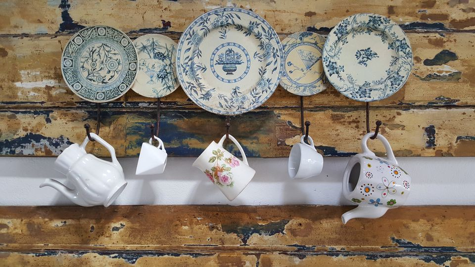 Plates and a tea set hanging on a wall