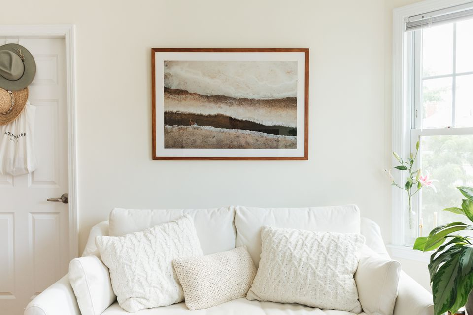 art print hung over a couch