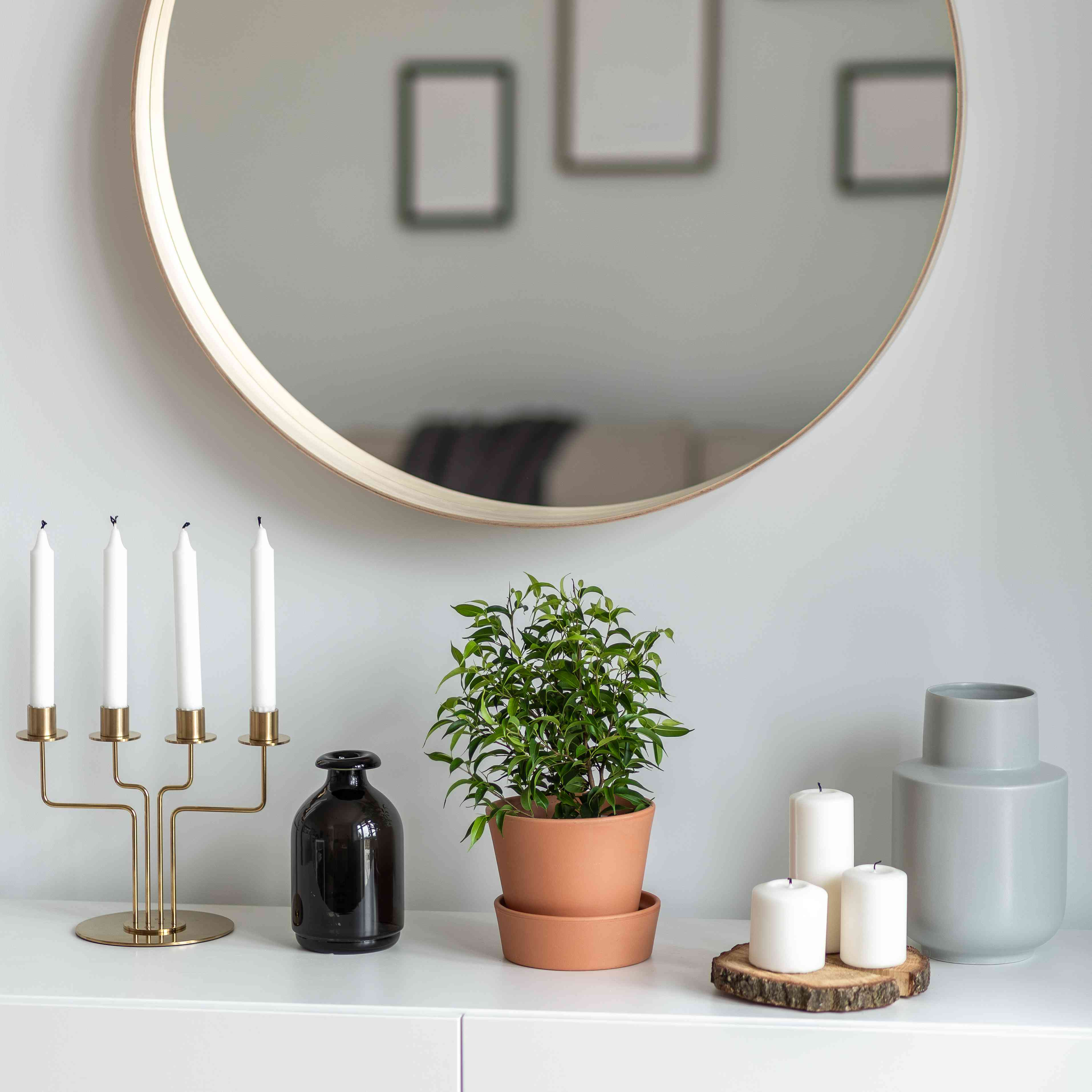 Decorative accessories on white sideboard