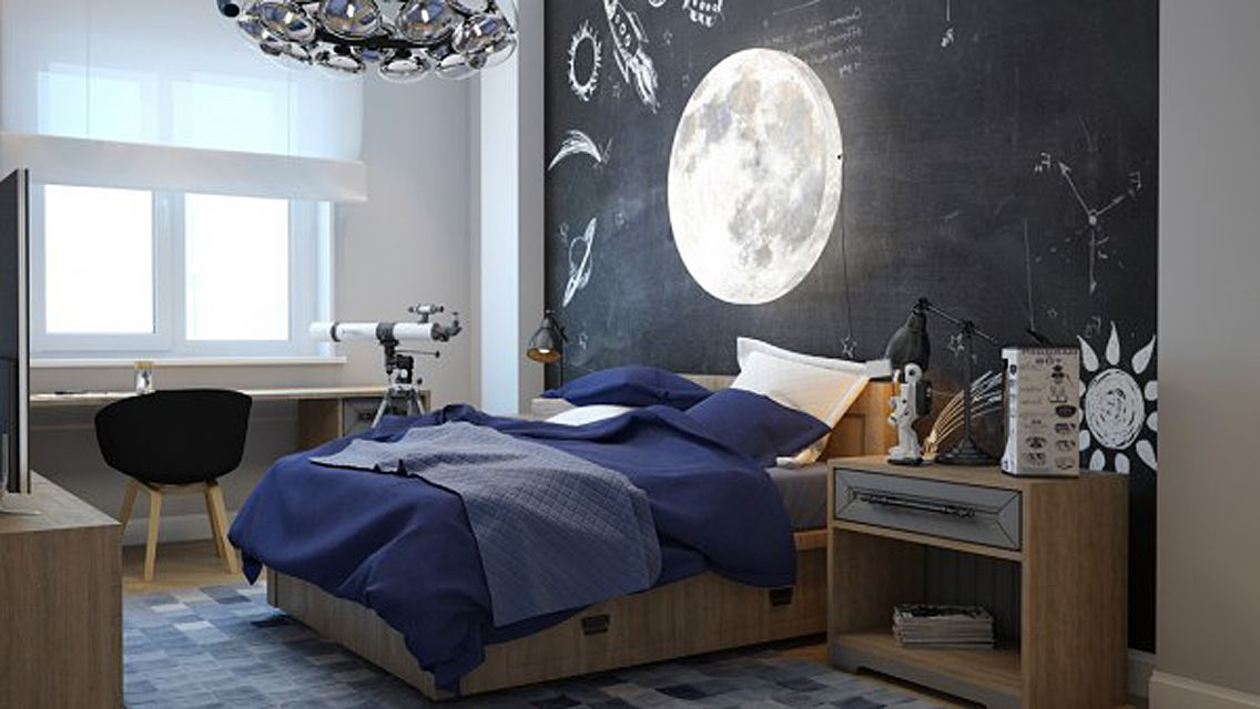 Space-themed kid's room with chalk board wall and industrial accessories