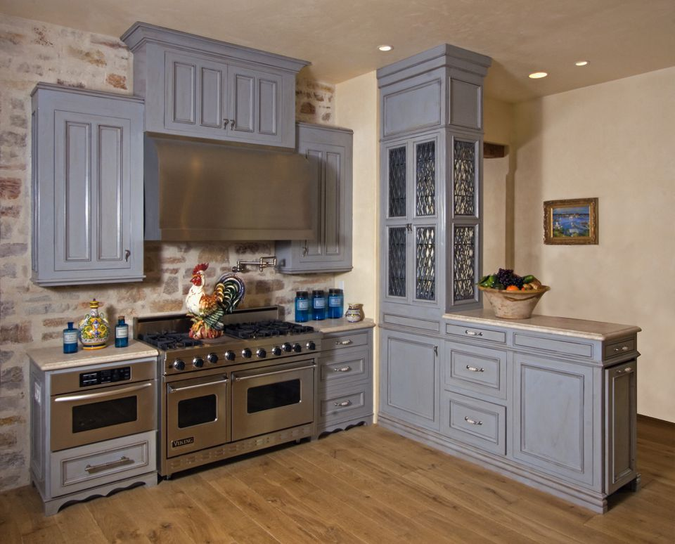 Blue Cabinets and Stone Wall in Kitchen