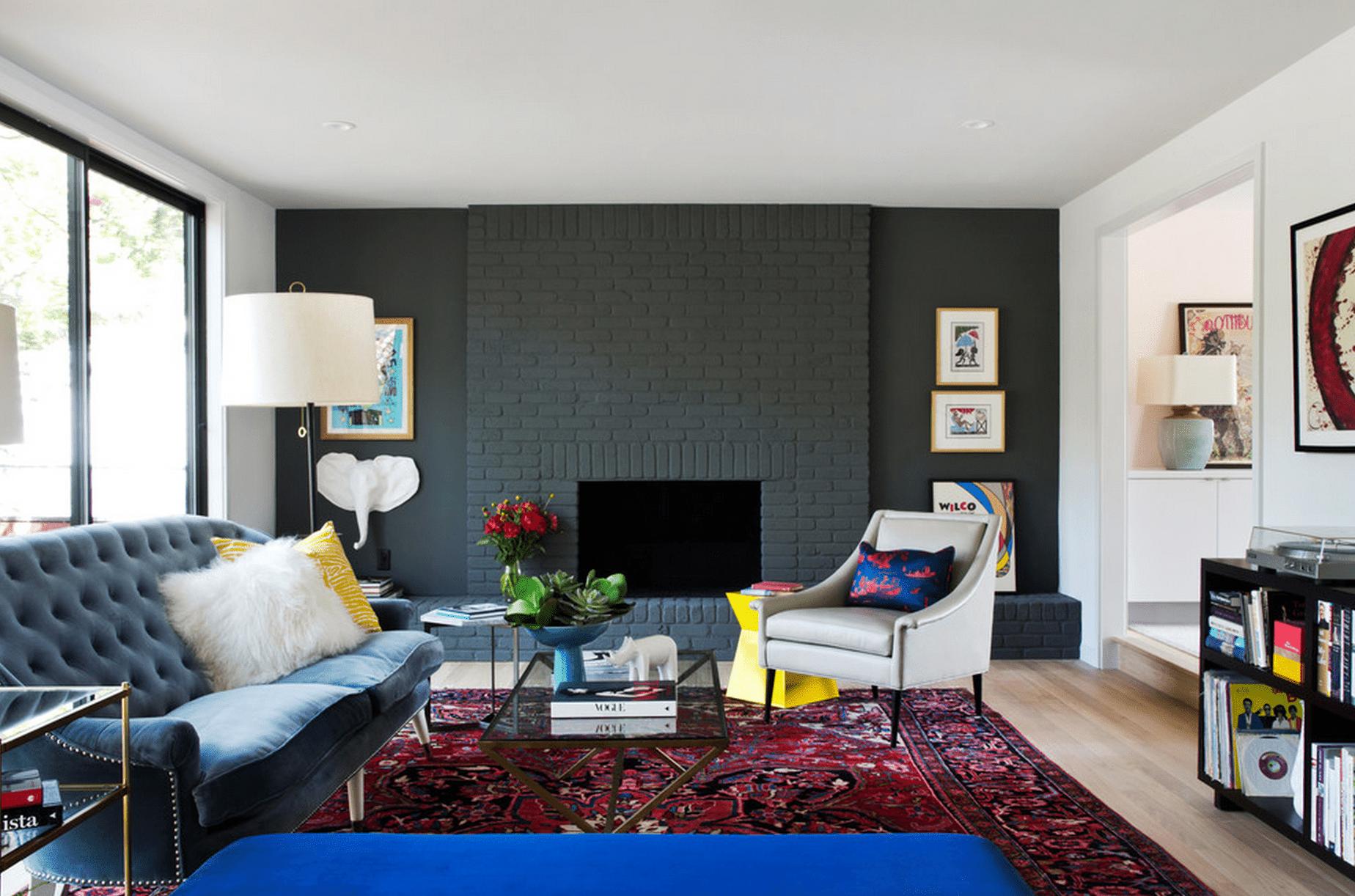 Living room with greyish black brick fireplace