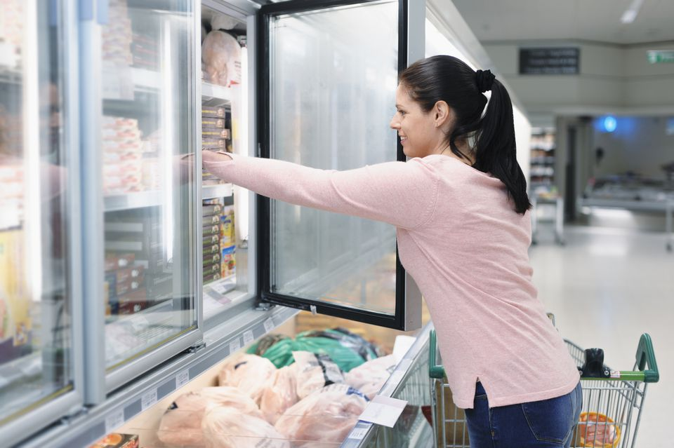 woman using freezer
