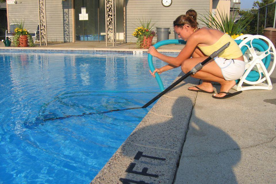 woman cleaning pool