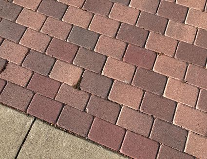 Cobblestone paved floor next to cement floor