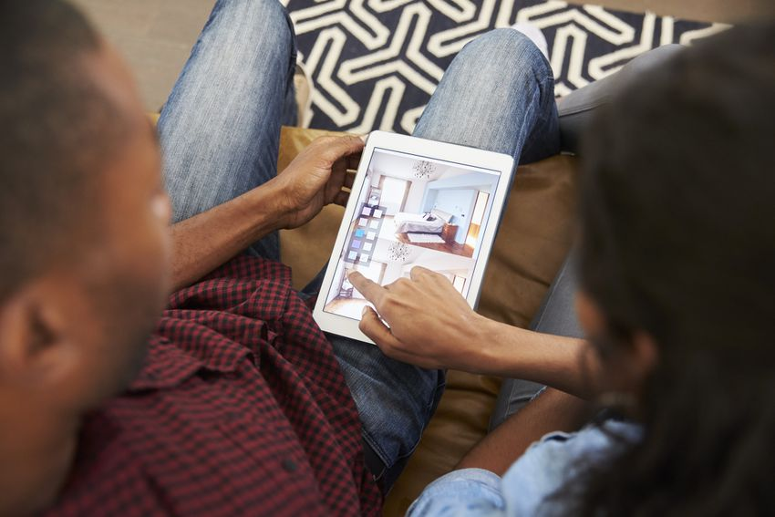 a couple looking at a home design app