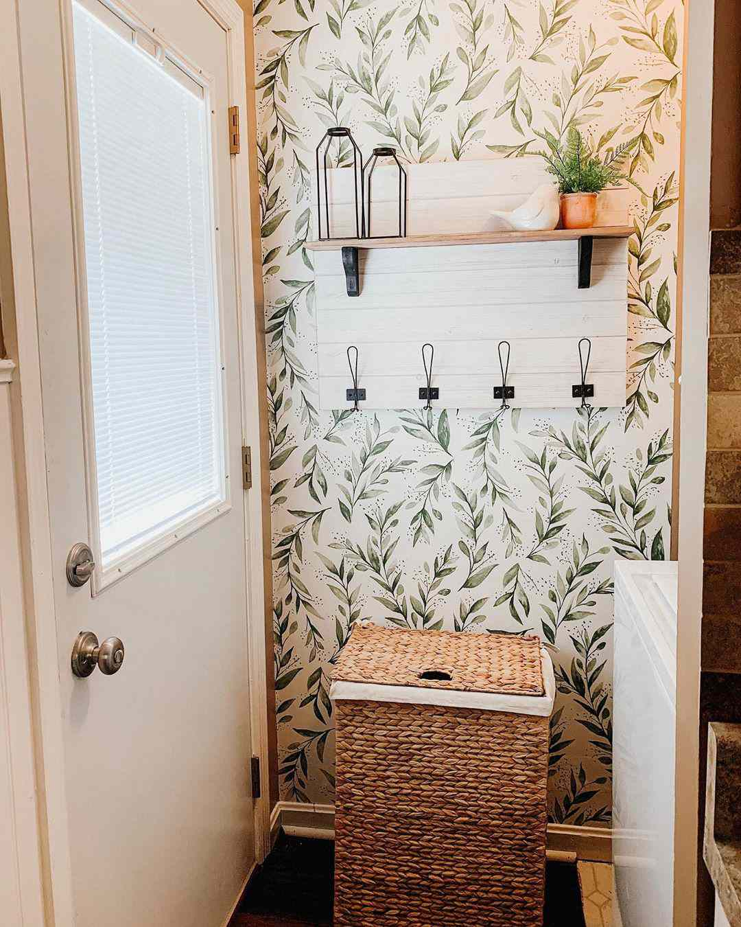 Small laundry room with green wallpaper