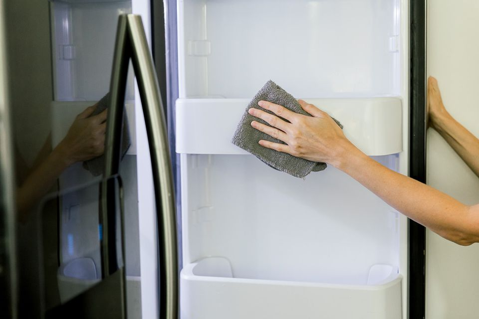 cleaning out a refrigerator