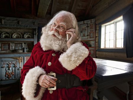 Get a free call from santa personalized for your child a picture of santa making a phone call spiritdancerdesigns Gallery