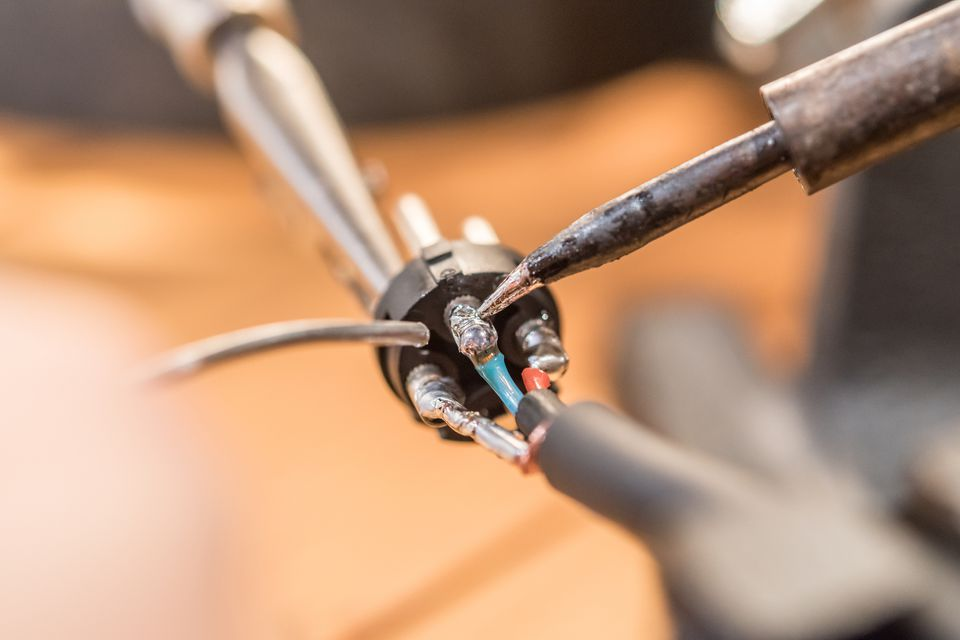 Close Up Man Hands Soldering Audio Cable with XLR Connector