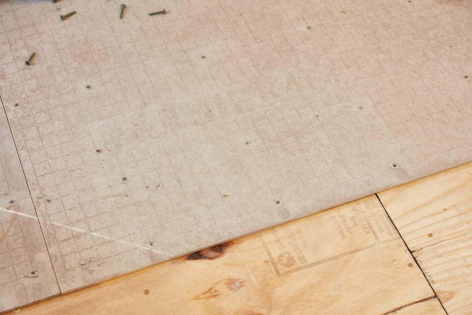 Cement-based backer board on wood floor for ceramic tiles