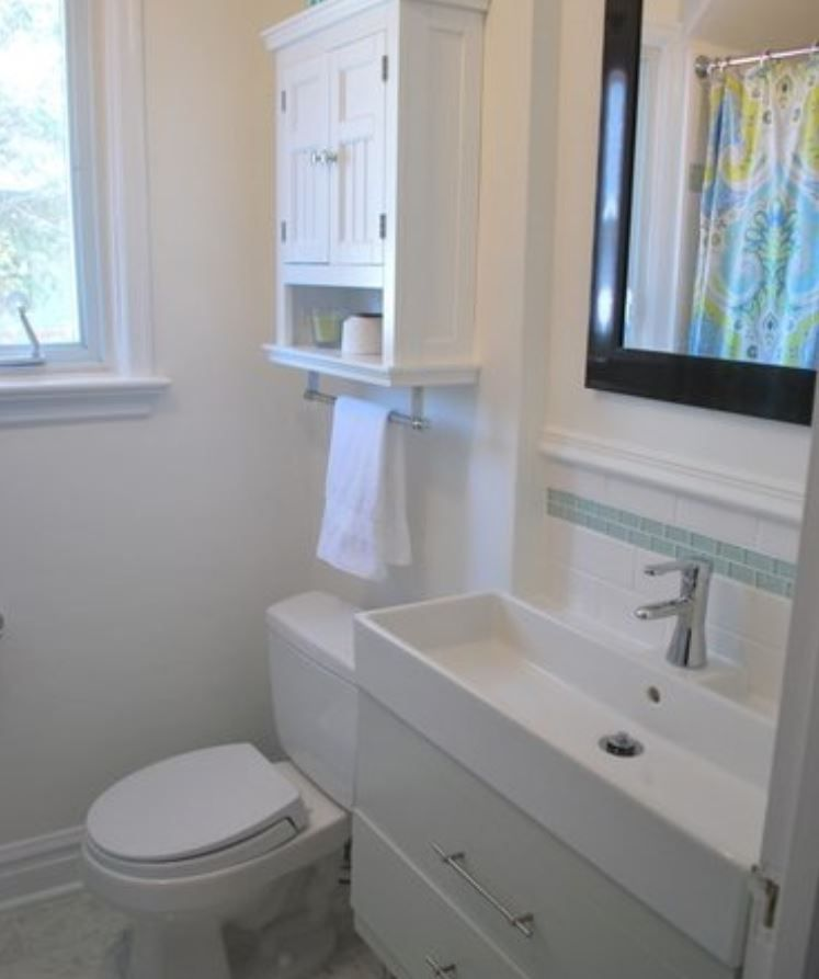 Powder room with white walls and fixtures.