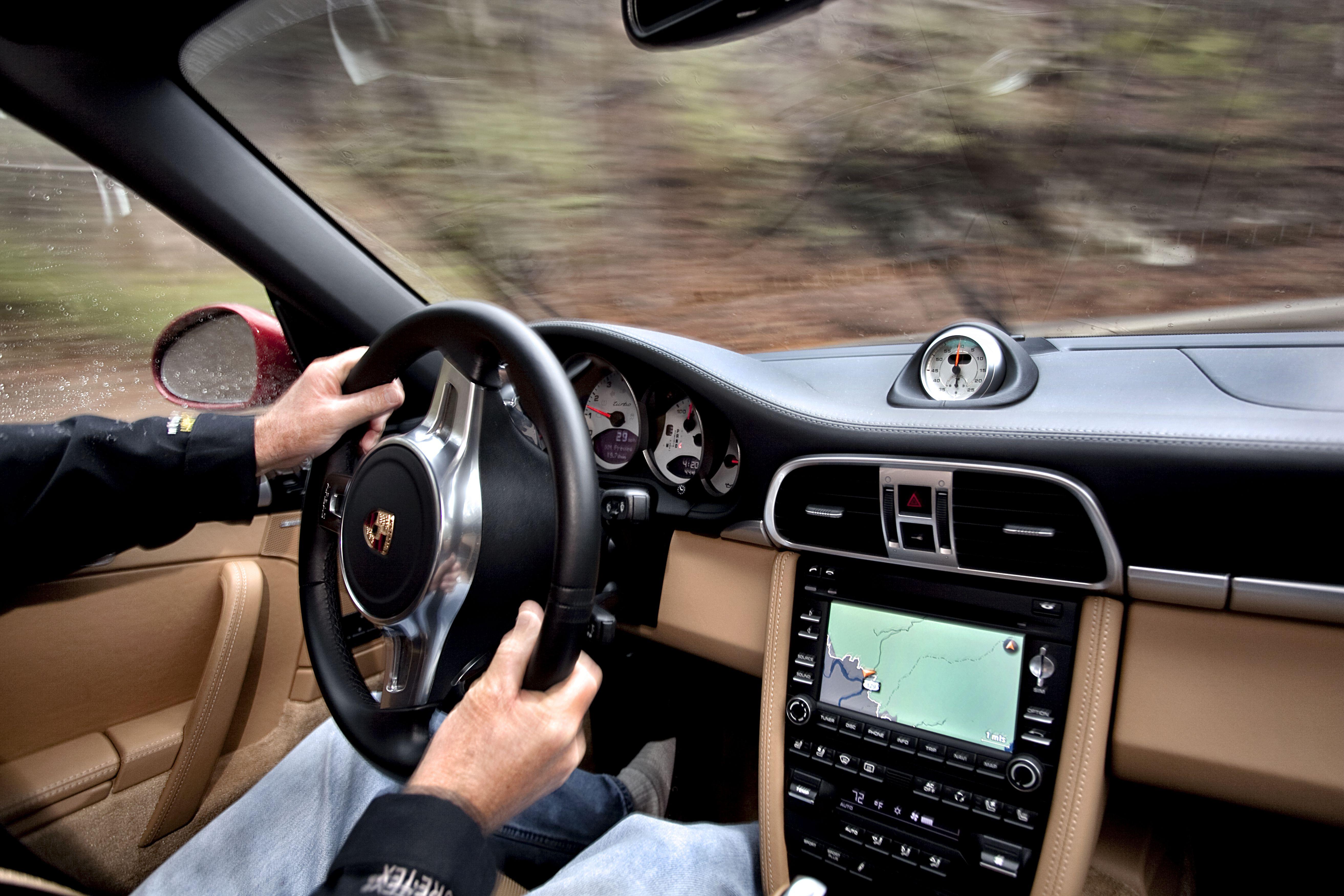 Man driving Porsche 911 Turbo