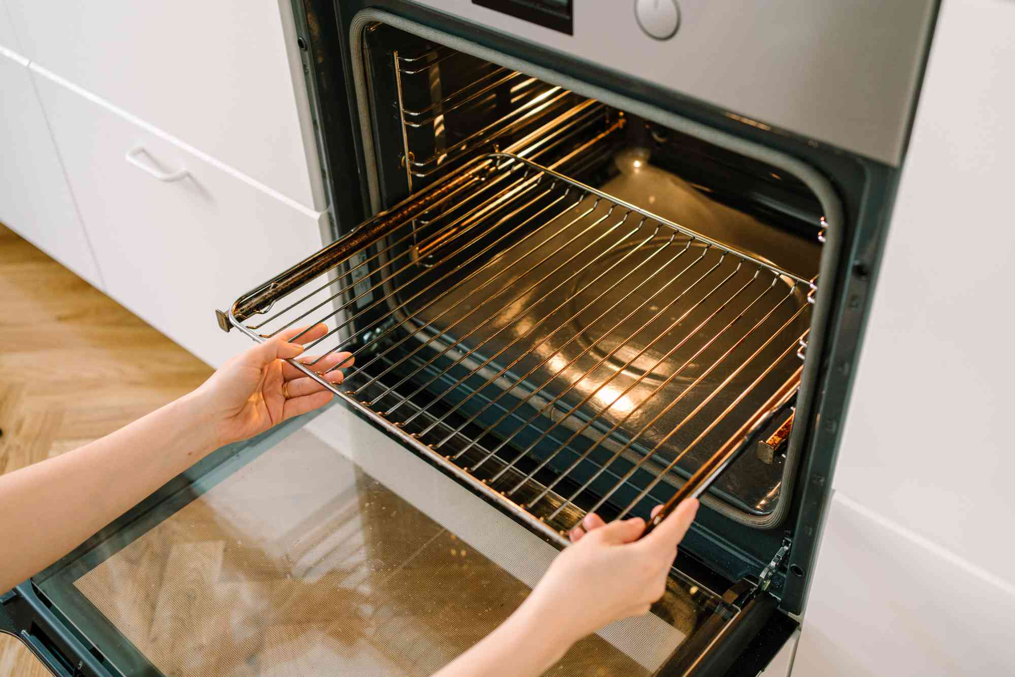 person removing the oven rack
